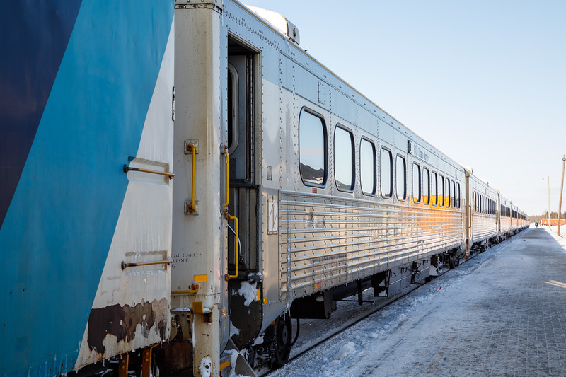 Polar Bear Express passenger consist. Nine coaches, two snack cars, two APUs plus baggage, boxcars and flatcars. Long train for people returning from Mushkegowuk Challenge Cup hockey tournament in Timmins. Coach 601 in foreground.