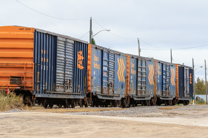 Boxcars on siding above the barge docks in Moosonee. ONT 2801, 2704,2702, 2708.