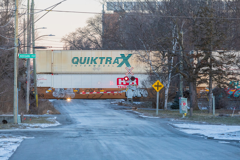 CP container train crossing Herchimer Avenue in Belleville Ontario around sunrise.