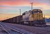 Ontario Northland Railway ballast train in Moosonee behind GP40-2 2202. HDR efx default. Just  before sunrise.