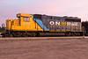 Ontario Northland Railway GP40-2 locomotive 2202 in Moosonee with ballast train 2016 August 27th.