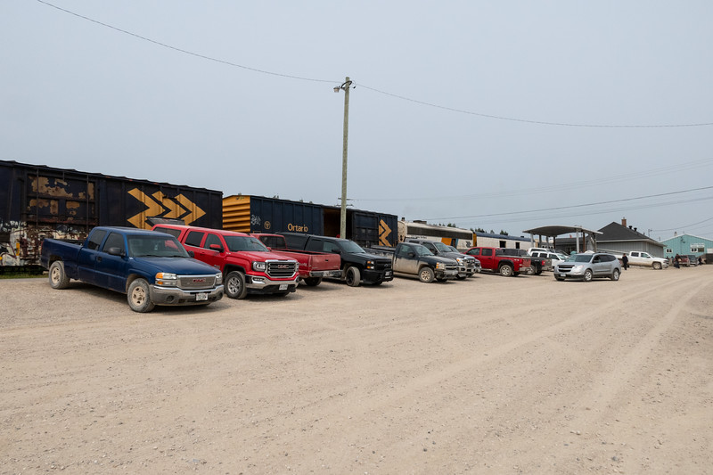 Vehicles parked at Moosonee station for the arrival of the Polar Bear Express.