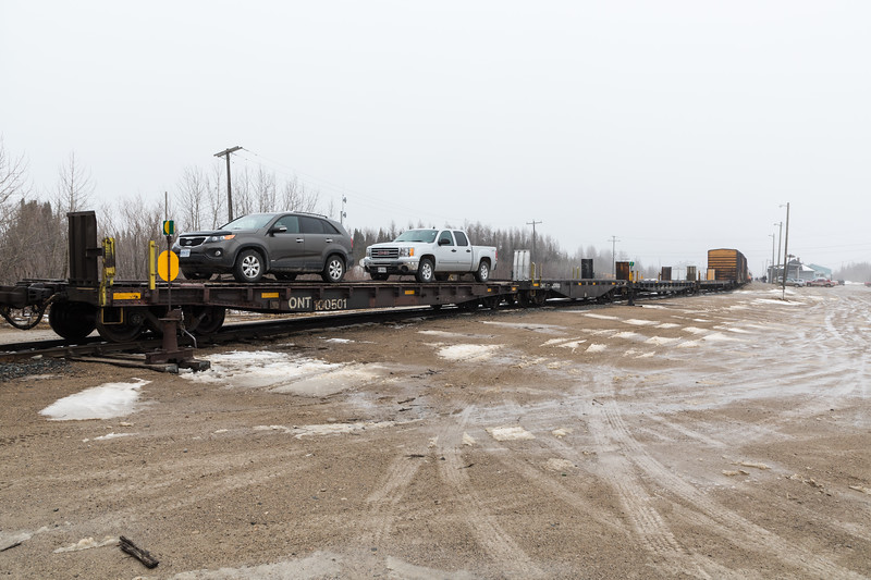 Chain or flat cars for vehicles in the consist of the Polar Bear Express mixed train in Moosonee.