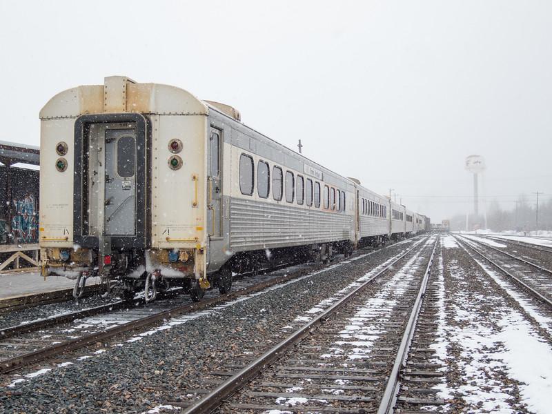 Polar Bear Express in Moosonee ready to head south. Coaches at rear, boxcars and flats behind locomotives.