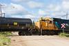 GP38-2 1808 and GP40-2 2202 switching tank cars across Bay Road in Moosonee.