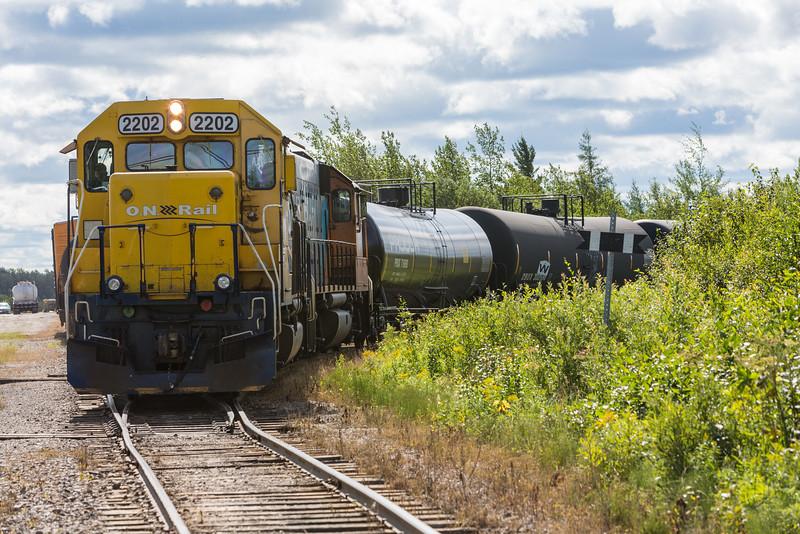 GP38-2 1808 and GP40-2 2202 head down siding leading to fuel storage along Ferguson Road in Moosonee.