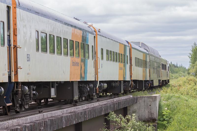 Passenger consist of the Polar Bear Express crossing Store Creek Bridge.