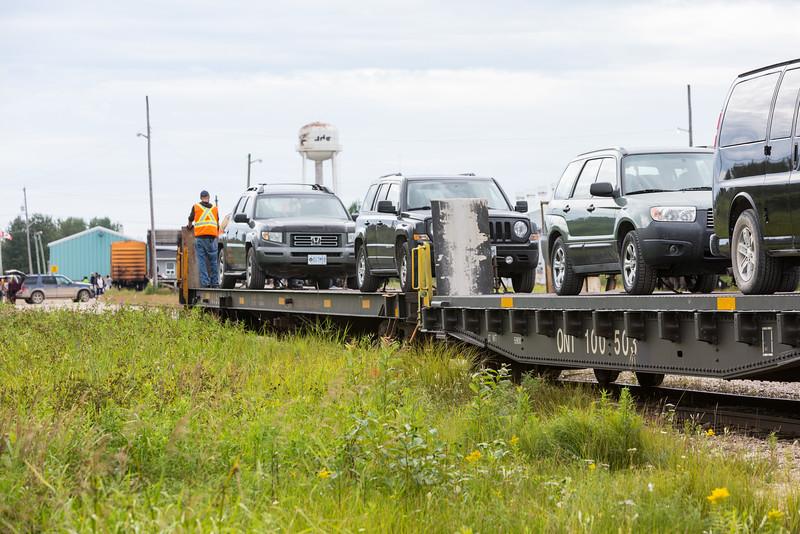 Flatcars for unloading head to platform.