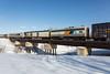 Polar Bear Express crossing Store Creekin Moosonee. Boxcar 7738, APU 203, baggage 412.
