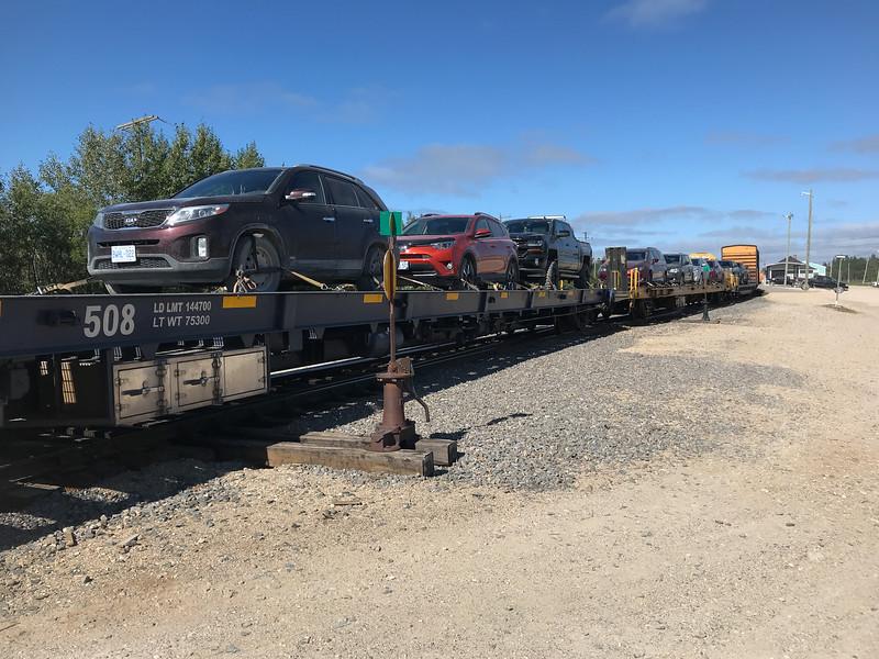 Vehicles on flatcars 2018 August 17.