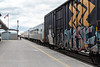 Passenger consist of the Polar Bear Express rolls up to station platform in Cochrane. 2017 May 16th.