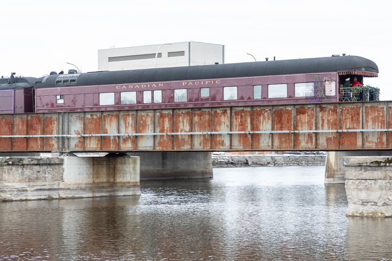 Canadian Pacific Railway Holiday train lead by GP20C-ECO 2249 crossing the Moira River. 2018 November 29. Business car Van Horne 77.