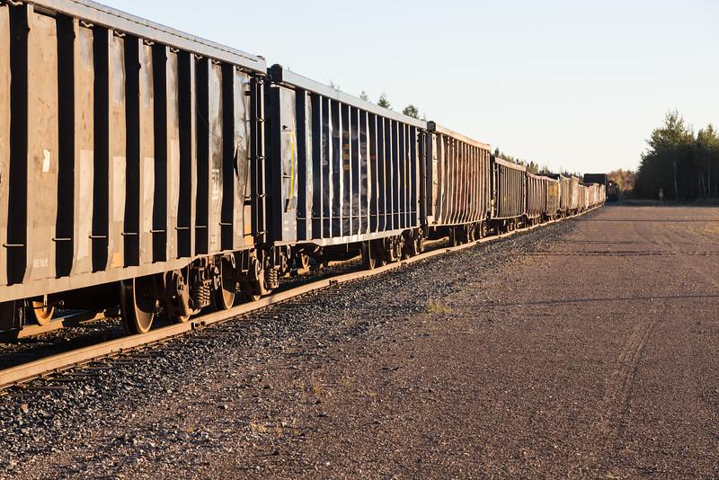Gondola cars in Moosonee. Used to bring gravel for Moosonee Airport repaving, held up due to derailment of GP38-2 1804.