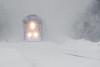 Polar Bear Express approaching Moosonee during a snow storm. Darker process.
