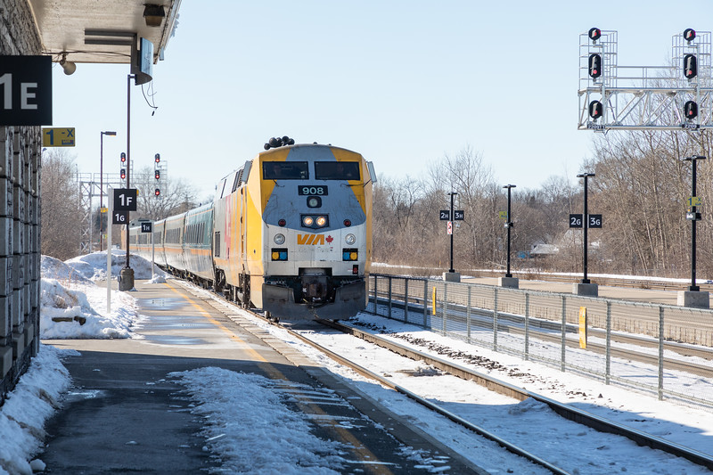 VIA P42DC locomotive 908 brings train 64 from Toronto into Belleville Ontario station 2019 February 16.