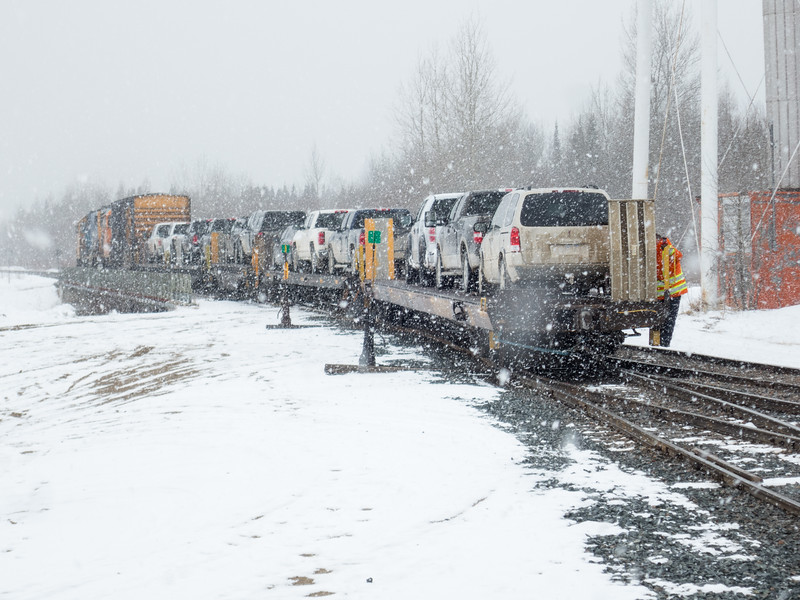 Locomotives, boxcar and flatcars for vehicles back towards rest of Polar Bear Express.