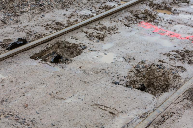 Broken culvert under rails.