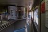 Snack car 701 in Cochrane. Looking from serving area down corridor, door for loading supplies open.