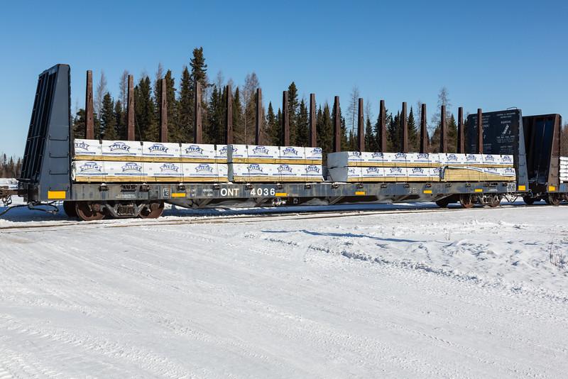 Treated wood products on centre post bulkhead car 4036 at Moosonee.