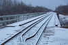 Looking down the tracks towards Cochrane across Store Creek bridge in Moosonee with fresh snow 2016 April 30th.