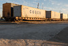 Boxcars and containers on flatcars on sidings on Revillon Road in Moosonee above the barge docks.