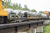 Vehicles on flatcars in the consist of the Polar Bear Express 2018 August 19.