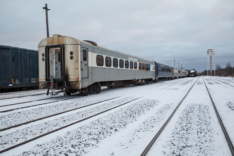 Polar Bear Express at Moosonee. Short train - three coaches and snack car. Freight cars beside. View from near diesel shed.