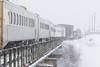 The Polar Bear Express mixed train crossing Store Creek on its way into Moosonee. Snack car 701.