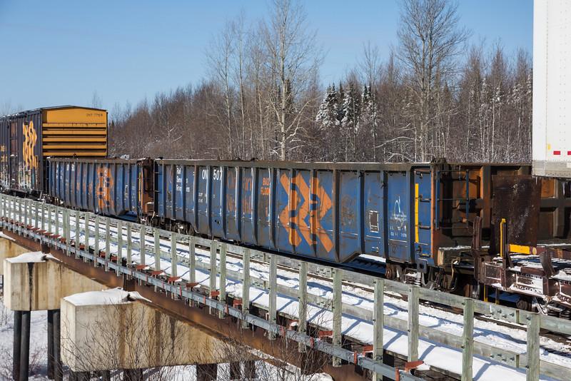 Ontario Northland Railway gondolas 5037and 5072 (labelled BAD FLOOR) cross Store Creek in Moosonee.