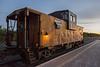 Ontario Northland Railway caboose 1873 in Moosonee at end odf ballast train.