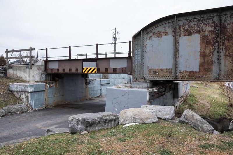 Short span of Canadian Pacific Railway bridge over roadway.