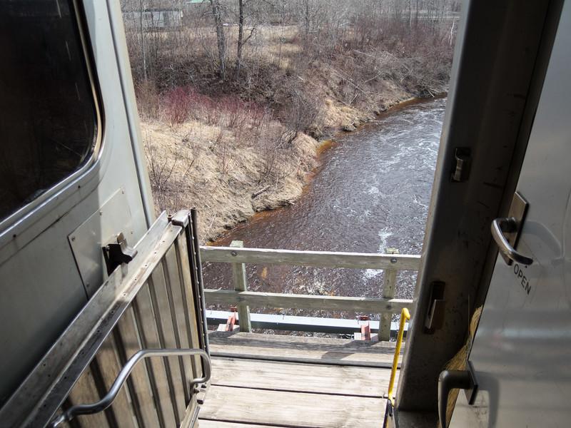 View through door of coach 615 crossing Store Creek in Moosonee.