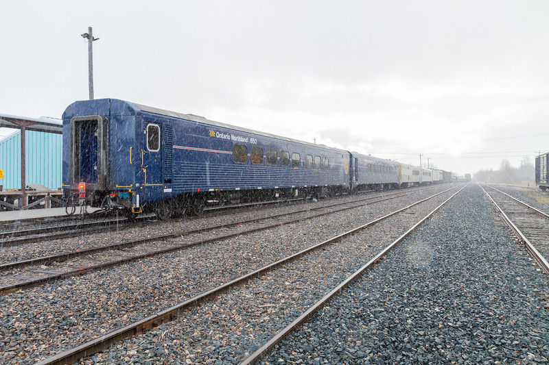 Polar Bear Express in Moosonee 2018 October 25 during light snowfall. End of train unit light visible.