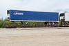 Dark blue reefer trailer on flatcar 1004??.