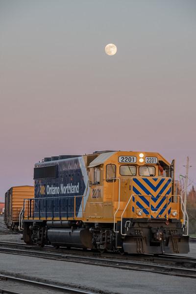GP40-2 2201 in Cochrane. under the moon