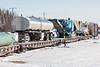Freight 419 heads into Moosonee. Heavy equipment and propane tanks.