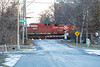 AC44EW locomotive CP 8611 is second unit in a container train crossing Herchimer Avenue in Belleville Ontario around sunrise 2018 December 27.