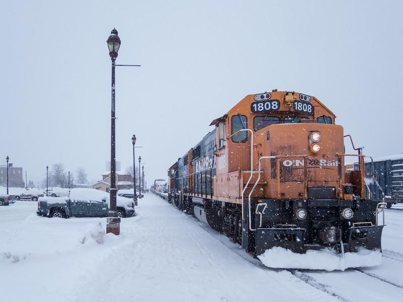 Polar Bear Express along station platform in Cochrane. GP38-2 1808 and 1801. Falling snow.