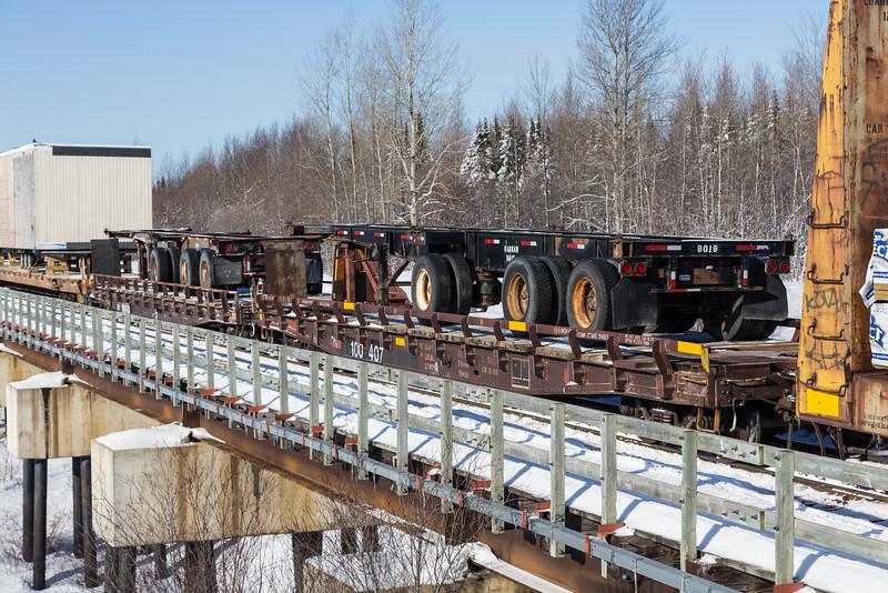 Transport trailer on flatcar 100407 on Store Creek railway bridge.