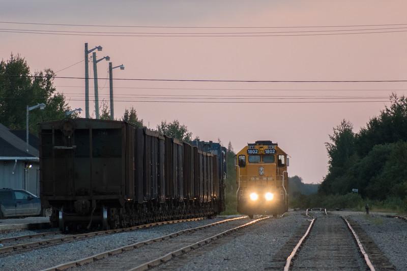 GP38-2 1802 beside rock (ballast) train at Moosonee shortly before sunset.