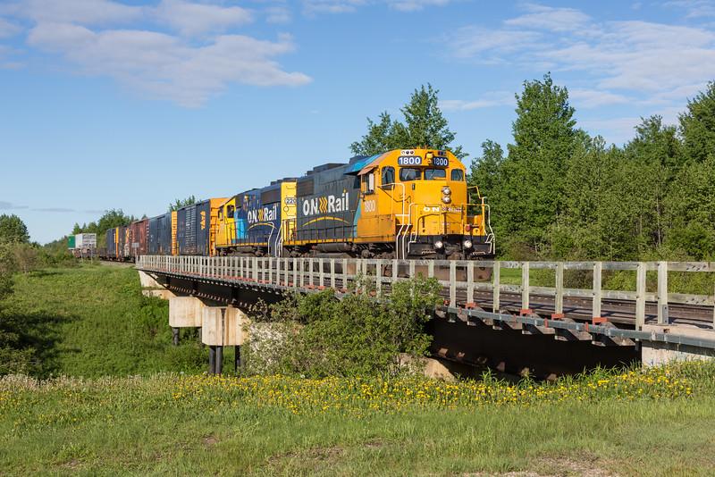Ontario Northland Railway freight rain 419 arrives in Moosonee behind GP38-2 1800 and GP40-2 2202.