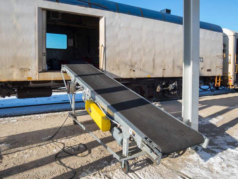 Baggage loading ramp in Cochrane in front of baggage car 413.
