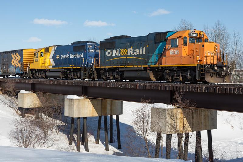 GP38-2s 1806 and 1809 lead the Polar Bear Express across Store Creek bridge in Moosonee.