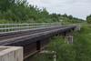 Railway bridge over Store Creek in Moosonee. Lead engine of the Polar Bear Express coming into sight down the tracks.