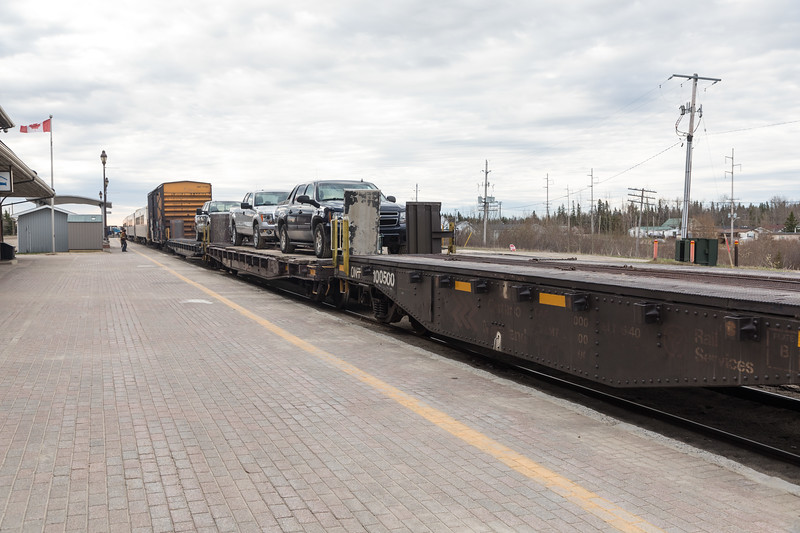 Chain cars (flatcars) for vehicles in the consist of the Polar Bear Express at Cochrane. ONT 100500