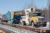 Heavy equipment in the consist of freight 419 crossing Store Creek in Moosonee.