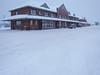 Cochrane train station. Falling snow.
