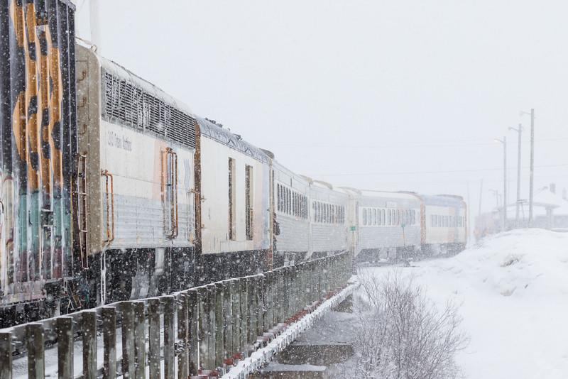 The Polar Bear Express mixed train crossing Store Creek on its way into Moosonee. APU 203.