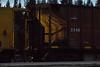Rock train in Moosonee. Hooper ONT 2248, front lit by light from GP38-2 1802.
