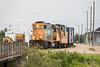 GP38-2 1808 with ballast / rock train in Moosonee. Caboose 1873.